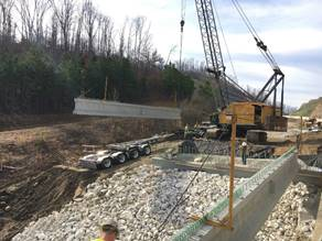 Additional beams will be set on the bridge over Burning Fork, on the west end of the Restaurant Row section of the Mountain Parkway Expansion project.