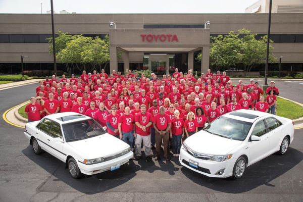 "Toyota Motor Manufacturing Kentucky (TMMK) team members in May celebrated 10 million vehicles assembled at the plant, posing with the ""first"" Camry built in 1988 and the milestone vehicle, a Camry Hybrid, built in 2014."