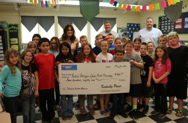 Rachel Frazier, a teacher at Jones Fork Elementary School, was joined by her students and Principal Brent Hall as Kentucky Power's Bob Shurtleff presents her with a Teacher Vision Grant to fund a virtual reality project.