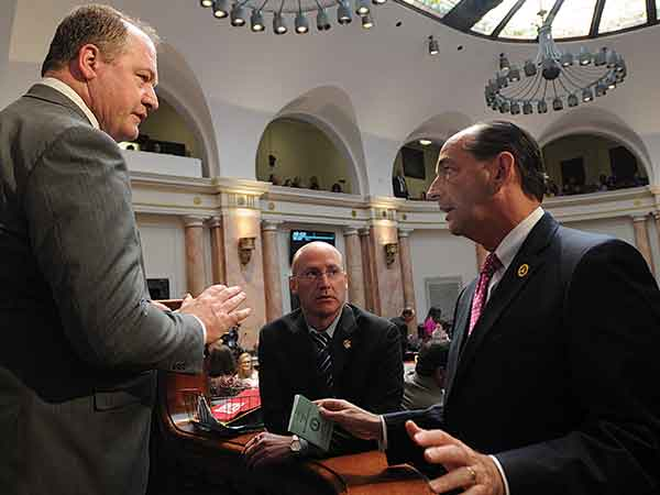 House Speaker Jeff Hoover, R-Jamestown, left, discussed a ruling on a bill with House Minority Floor Leader Rocky Adkins, D-Sandy Hook, in the House on March 8.