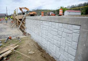 Crews are working on retaining walls near Magoffin County High School.