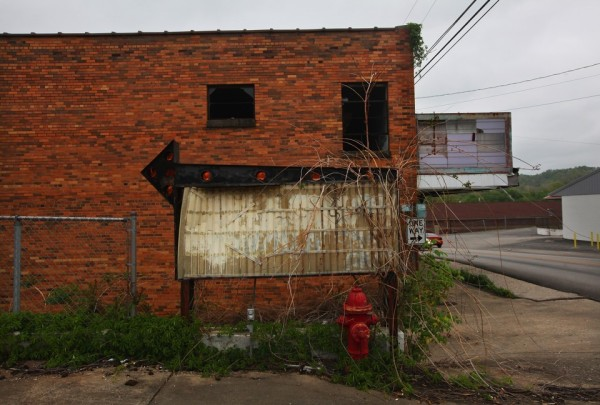 An old sign was stored next to a building in Booneville, Owsley County in 2012. (The Atlantic)
