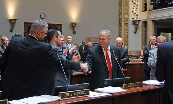 Sen. Mike Wilson, R-Bowling Green, center, was congratulated by fellow senators upon the final passage of SB 1, an act relating to reform of public education accountability, in the Senate.