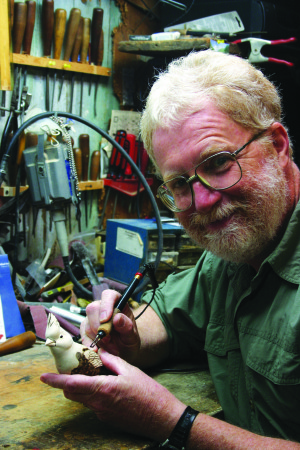 Wood sculptor Tim Hall carves birds in realistic settings and is an artist in the Kentucky Arts Council's Kentucky Crafted Program.