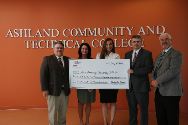 Kentucky Power's Brad Hall, left, presented an AEP Foundation Credits Count grant to Ashland Community & Technical College for Lawrence County Schools. Also present, from left, are Sharon Parsons, Lawrence County Schools; Mia Brown, Credits Count ACTC project director; Robbie Fletcher, Lawrence County Superintendent; and Keith Brammell, ACTC Interim Dean.