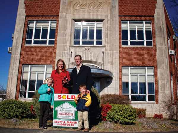 Meagan and Ed Musselman with two of their children on closing day of the Coca-Cola bottling plant in downtown Paducah in 2013.
