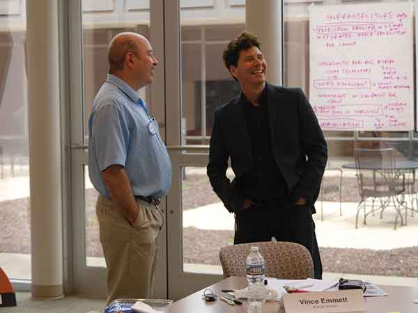 Vince Emmett, left, chatted with Neil Kesterson June 23 at an NEA Technical Arts Roundtable in Lexington. Emmett is a Louisville-based composer who has written several soundtracks.