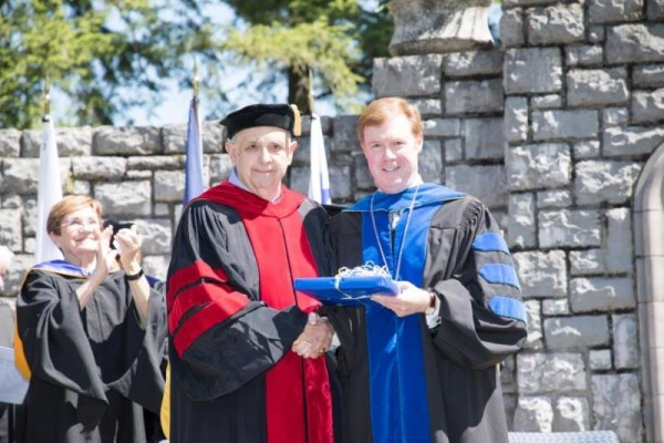 Midway University President Dr. John P. Marsden (right) announced that the institution's Board of Trustees had voted unanimously to confer emeritus status upon Dr. William Brown.