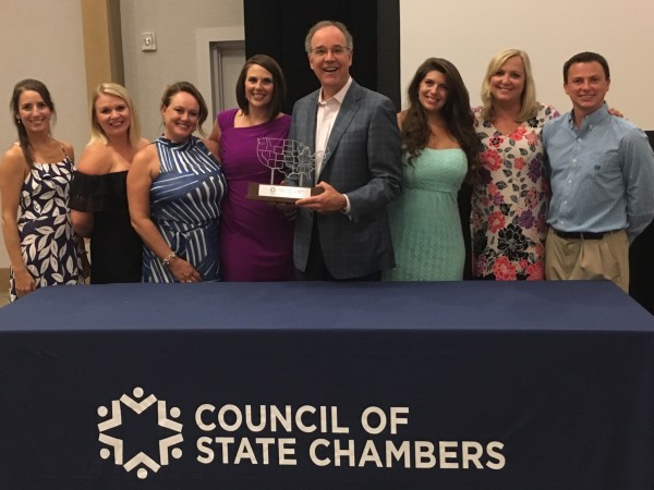 Kentucky Chamber President and CEO Dave Adkisson, center, accepted the award along with some of the Chamber staff.