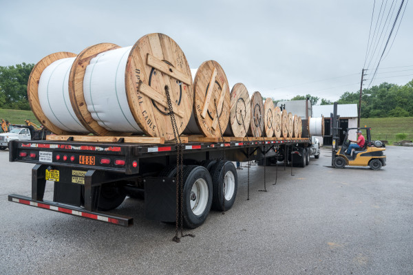 Trucks arrived in Barbourville last week carrying more than 90 miles of fiber optic cable.