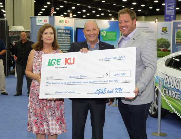 LG&E and KU Energy Efficiency Program Manager Rhonda Truman (left) and Manager of Energy Efficiency Operations Jeff Myers  (center) presented Kentucky Venues President and CEO Jason Rittenberry with rebate dollars earned through participation in the company's Commercial Rebates Program.