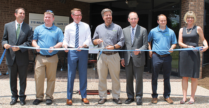 Dignitaries cut the ribbon to MosquitoMate's new production facility in Lexington.