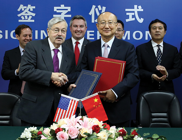 Agriculture Commissioner Ryan Quarles, center, stood behind U.S. ambassador Terry Branstad and AQSIQ Minister Zhi Shuping after the signing of an accord which allows the resumption of equine exports to China.