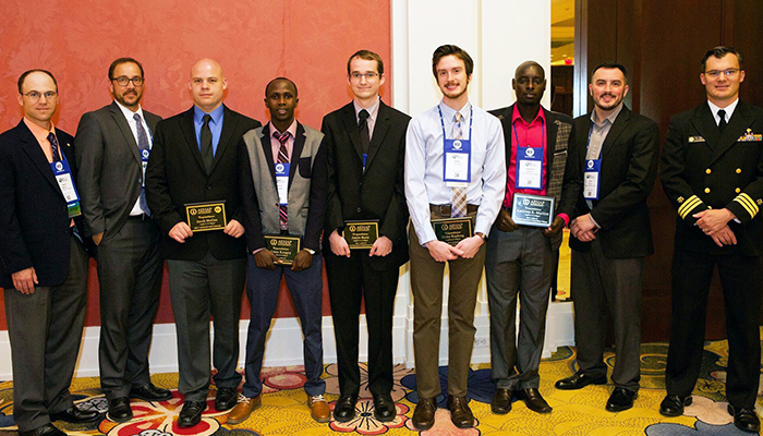(From left): Dr. Jason W. Marion, EKU EHS faculty; Derek DeLand, environmental health programs manager, NSF International; Jacob McGee, EKU award recipient; Amos Kosgey, EKU award recipient; Justin Bunn, student, East Carolina University; Blake Rushing, student, East Carolina University; Ambrose Maritim, EKU award recipient; Dr. Clint Pinion, EKU EHS faculty; and CDR Jasen Kunz, U.S. Public Health Service-CDC National Center for Environmental Health.