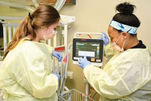 Erin Feeney, R.N., right, explained use of a patient monitor to apprentice Natalia Dickerson in the Norton Women's & Children's Hospital Pediatric Emergency Department.