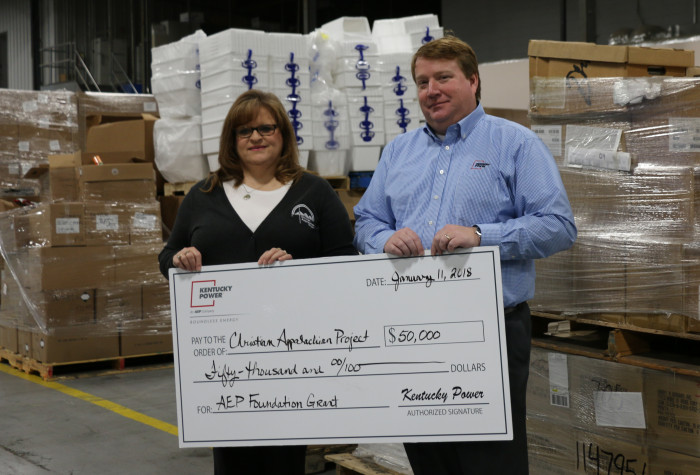 Kentucky Power President Matt Satterwhite presented a $50,000 AEP Foundation grant to Teresa Gullett, manager of Elderly Services for Christian Appalachian Project, at the agency's warehouse in Paintsville.