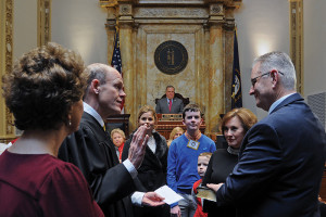 Sen. Jimmy Higdon, R-Lebanon (right), is sworn in as Senate President Pro Tem by the Honorable Samuel T. Spalding, Judge of the 11th Judicial Circuit, as Higdon's family watches on the opening day of the 2018 General Assembly session.
