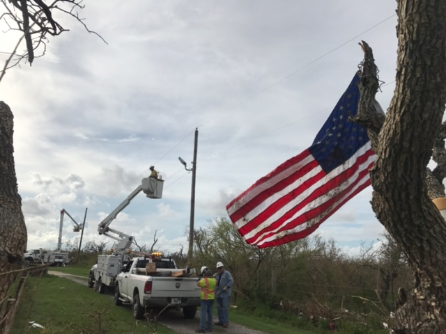 Kentucky Power crews flew an American flag found in debris from a tree on their last day of restoring power in Rockport Texas