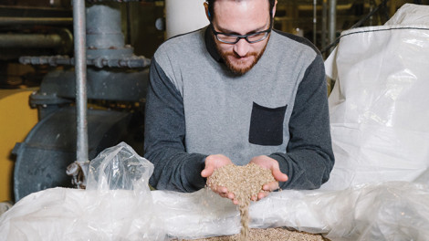 Victory Hemp Foods of Campbellsburg in Henry County is aiming for ambitious growth as Americans become aware of the benefits of hemp protein. CEO/Founder Chad Rosen examines product derived from hemp seeds at the company's processing facility.