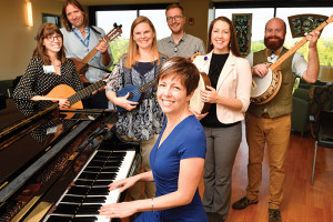 The music therapy team at Norton Healthcare are from left, Alex Ruffner, Brett Northrup, Kerry Willis, Kyle Hubert, Melanie Brison, Brian Schreck and Jenny Branson (seated).