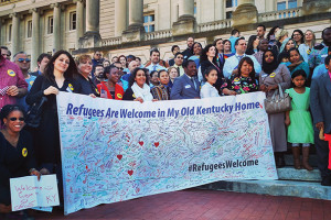 "Kentucky immigrants and refugees gather outside the Capitol in 2016 for a ""keep Kentucky global"" initiative on behalf of Kentucky Office for Refugees, Kentucky Refugee Ministries, Americana World Community Center, Catholic Charities/Migration & Refugee Services, and the International Center of Kentucky."