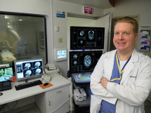 Dr. William Gump, pediatric neurosurgeon, gets ready to perform laser ablation surgery at Norton Children's Hospital.