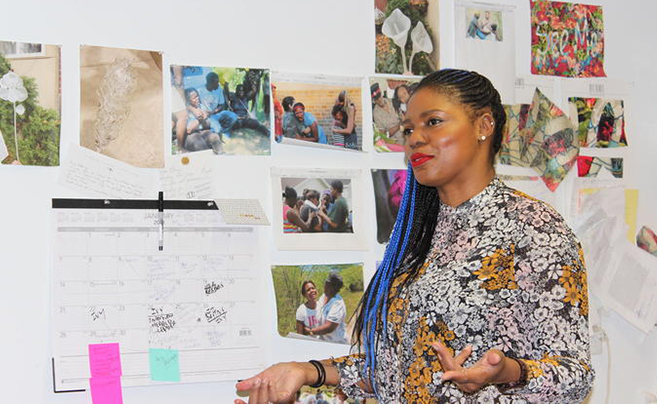 Ebony G. Patterson responds to questions during an interview in her studio at the Art and Visual Studies Building. Photo by Whitney Hale, UK Public Relations & Marketing.