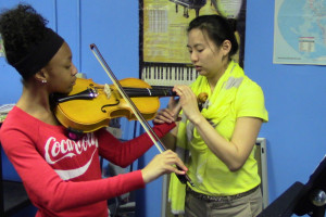 Gloria Lee teaches a private lesson to a student.