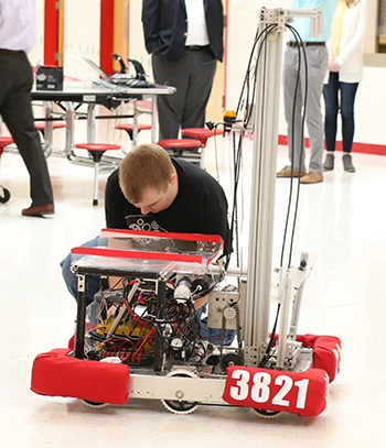 A member of Belfry High School's robotics team changed the battery on this year's robot.