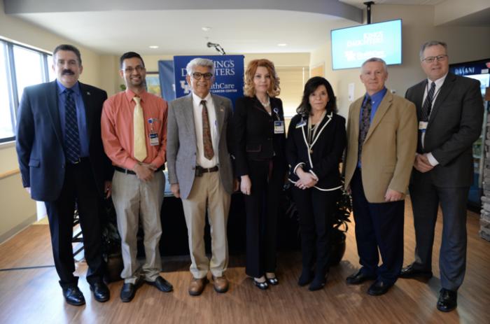 (L-R) Dr. Mark Newman; KDMC's Jaskirat Randhawa, Dr. Vinay Vermani, Dr. Galena Salem, CEO Kristie Whitlach & Dr. David Goebel; UK's Dr. Tim Mullett.