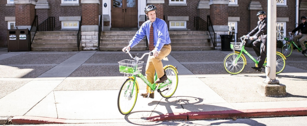 Members of the EKU President's Council take the LimeBikes for a test spin.