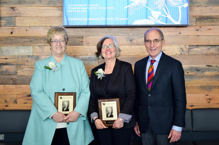 2018 Sarah Bennett Holmes Award winners Debra Moser, left, and Lisa Collins with UK President Eli Capilouto. Photo by Sarah Caton.