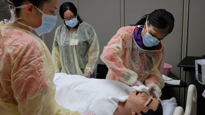 UofL Master's Entry into Professional Nursing students train in a clinical simulation.
