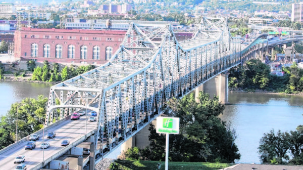 The Brent Spence Bridge is a double decker, cantilevered truss bridge that carries Interstates 71 and 75 across the Ohio River between Covington, Ky. and Cincinnati.