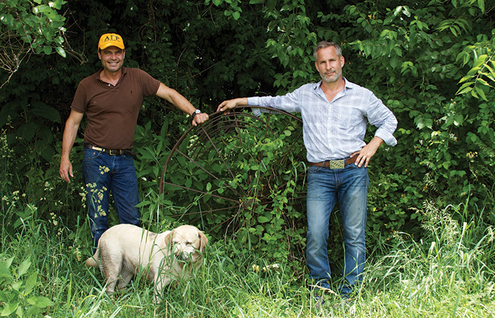 Jon Carloftis, left, and Dale Fisher conduct a search for obsolete farm equipment to use as art on an old friend's farm in Woodford County. Farm Chic has been one of their recent landscape design themes.