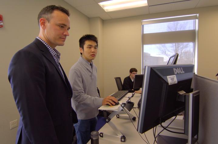 "Chad Risko and graduate student Qianxiang ""Alex"" Ai work in the computational lab at the UK Center for Applied Energy Research (CAER)."
